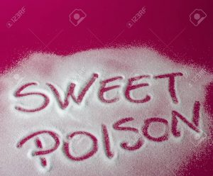 Sugar on a red background with warning message SWEET POISON written on it. Health concept. Diabetes hazard